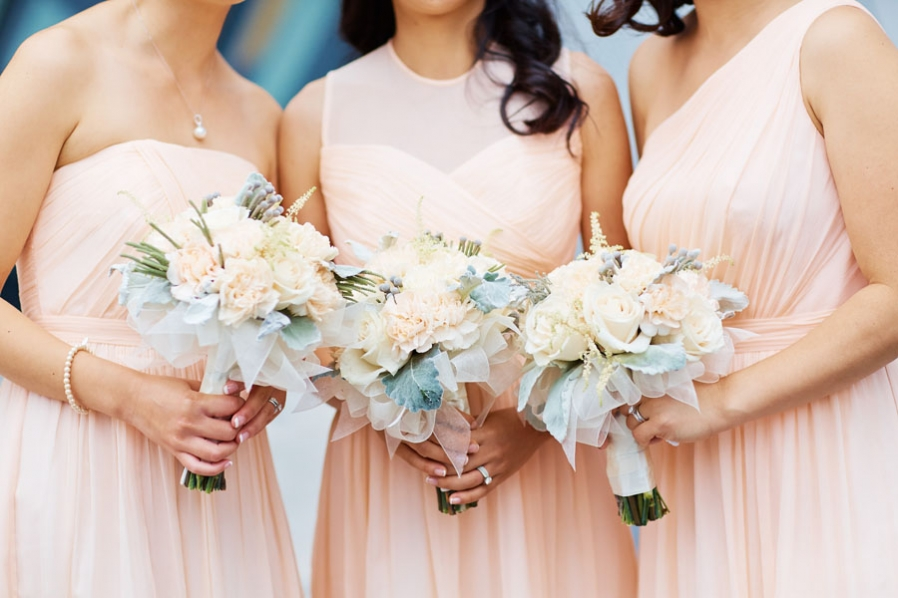 outdoor tent wedding blush ivory bouquets